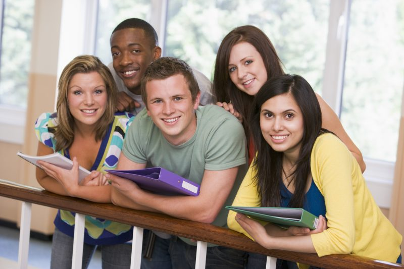 Group of college students leaning on banister