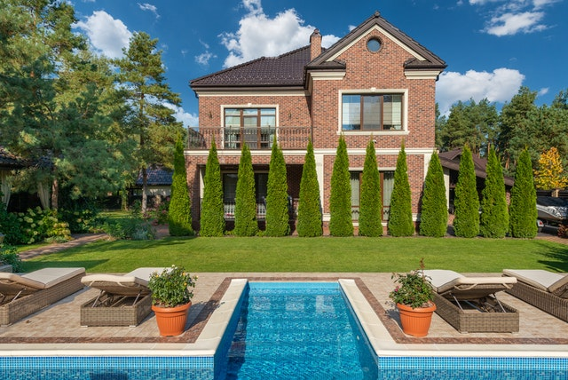 a residential mansion with terrace and pool